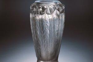This vase is embellished with eucalyptus leaf motifs