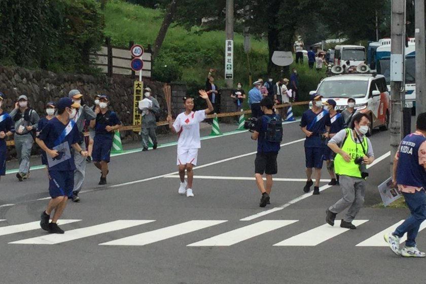 Olympic torch runner coming from Koma Jinja