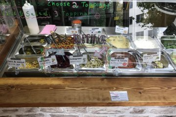 There are numerous salad and sauce options to fill your falafel sandwich with