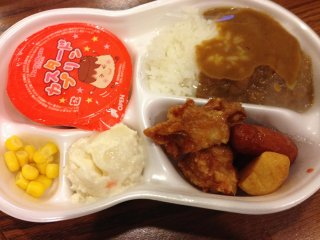A kid's curry rice and chicken karaage set