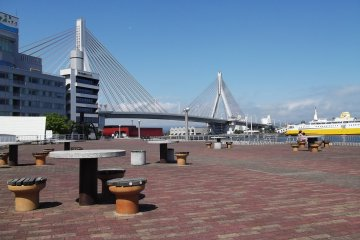 Sit with a drink or snack and a view of the graceful harbor bridge