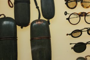 Old glasses and cases on display