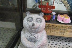 A happy tanuki statue.
