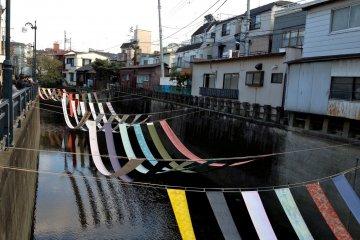 <p>Kimono silk draped for 100 meters along the Miyosoji River (2013)</p>