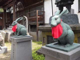 Some temples have lion guardians; this one has rabbits