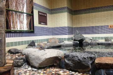 Outdoor baths on the the top floor of the hotel