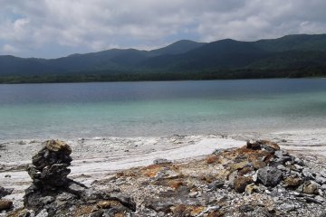<p>Jagged rock, soft sand, clear and peaceful water</p>