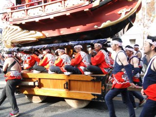 Musicians sitting on the float's base