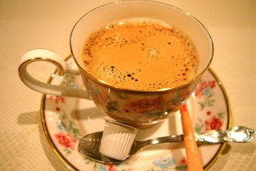 A beautiful cup of coffee to end off a scrumptious meal.