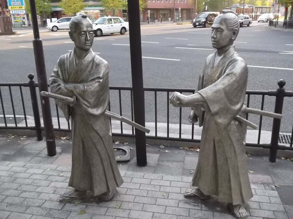 Two local samurai discuss the future of Japan