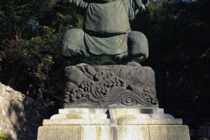 One of the Seven Lucky Gods of Fortune, Ebisu, greets visitors at the top of the hill.