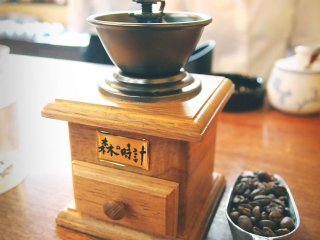 You are required to ground your own coffee using this nifty mini coffee grinder that works in a clockwise direction.
