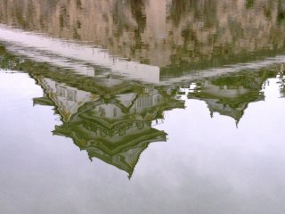Reflections of Kishiwada Castle on the moat