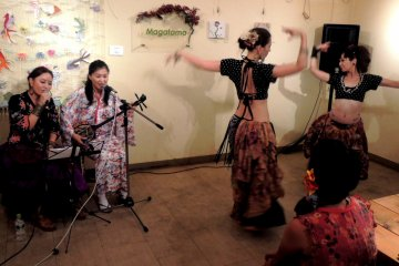 <p>Magatama Cafe and Bar is a friendly community arts space near Tamatsukuri Station. Drop in for folk dancing performances</p>
