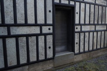 <p>Here is an outer wall of the house -&nbsp;like a fortress. Much thought and investment went into&nbsp;fire-proofing the house. The house&nbsp;stands with a certain dignity and endurance as the rest of the city changes with the times.</p>