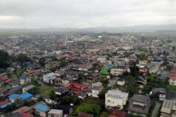 <p>A view of Kakuda&nbsp;City. The residential areas have&nbsp;a bit more color&nbsp;to its architecture than most Japanese towns.</p>