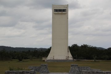 <p>The surrounding recreation area at Kurshiki Dam includes the jogging track and wide open grassy area around the tower</p>