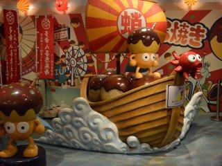 Maskot kecil yang lucu dari Museum Takoyaki.