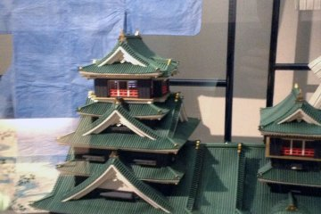 <p>A paper castle stands proudly in front of paper clothing once worn by a famous kabuki actor.&nbsp;</p>