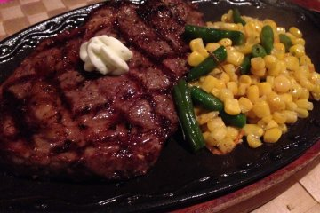 <p>The ribeye steak dinner comes with a sizeable portion of beef and vegetable of the day</p>