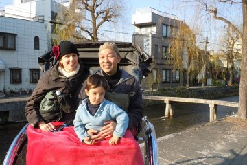 <p>Our family in the rickshaw at the end of our 10 minute odyssey</p>