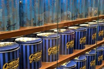 <p>Garrett Popcorn Shops signature tins: Signature Blue Tin &amp; Garrett Signature Snowflake</p>