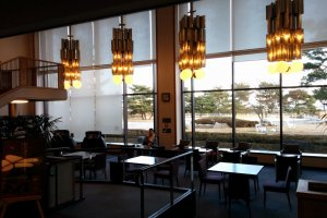 The lounge opposite the lobby features views, pay massage chairs, and a 3000 comic/manga library.