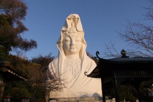 This statue, a bust figure which is pure white and sits high up on a hill overlooking Ofuna Station, can be seen from miles.