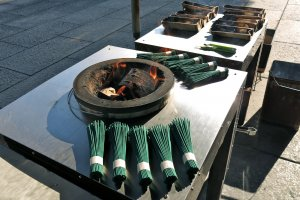Most visitors purchase incense to burn and then pray at each of the 47 loyal retainers graves