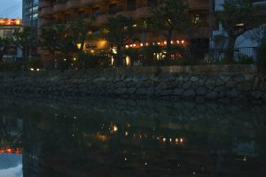 Reflection of the Hotel Sun Palace Kyuyoukan over the canal