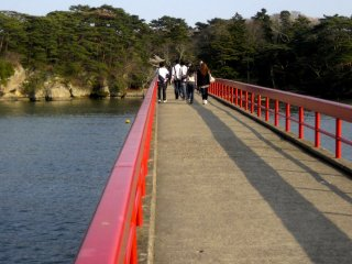 The long bright red foot bridge that connects Fukuurajima to the ticket office and the mainland.