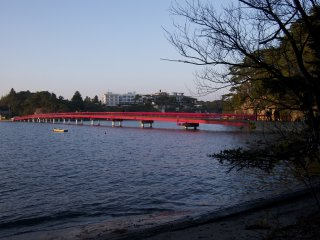 View of the red bridge from Fukuurajima's first beach facing the mainland.