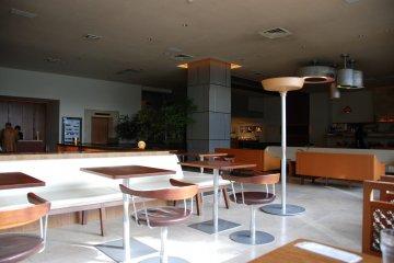 <p>The lobby, bar and restaurant&nbsp;</p>