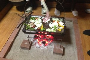 Local food cooked on a hot plate over a danro, or hearth.