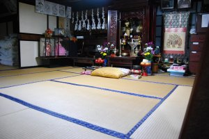 A traditional buddhist altar (butsudan) set in a tatami room.