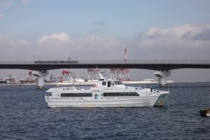 The ferry setting off for Kansai International Airport, with the PortLinerin the background on its way into Kobe