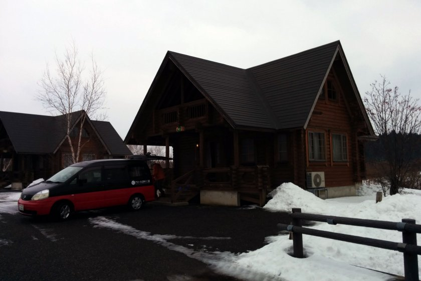 Log houses have six beds and are two stories. There is room to park your car at the log house for unloading or use the free 150 car parking lot.