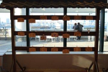 <p>Ema boards hanging in the Aqua City Odaiba Shrine</p>